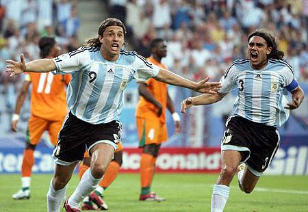 Argentina's Crespo celebrates his goal against Ivory Coast with team mate Sorin during their Group C World Cup 2006 soccer match in Hamburg