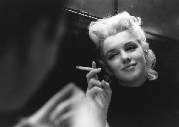 Marilyn Monroe with Cigarette --- Image by ゥ Michael Ochs Archives/Corbis